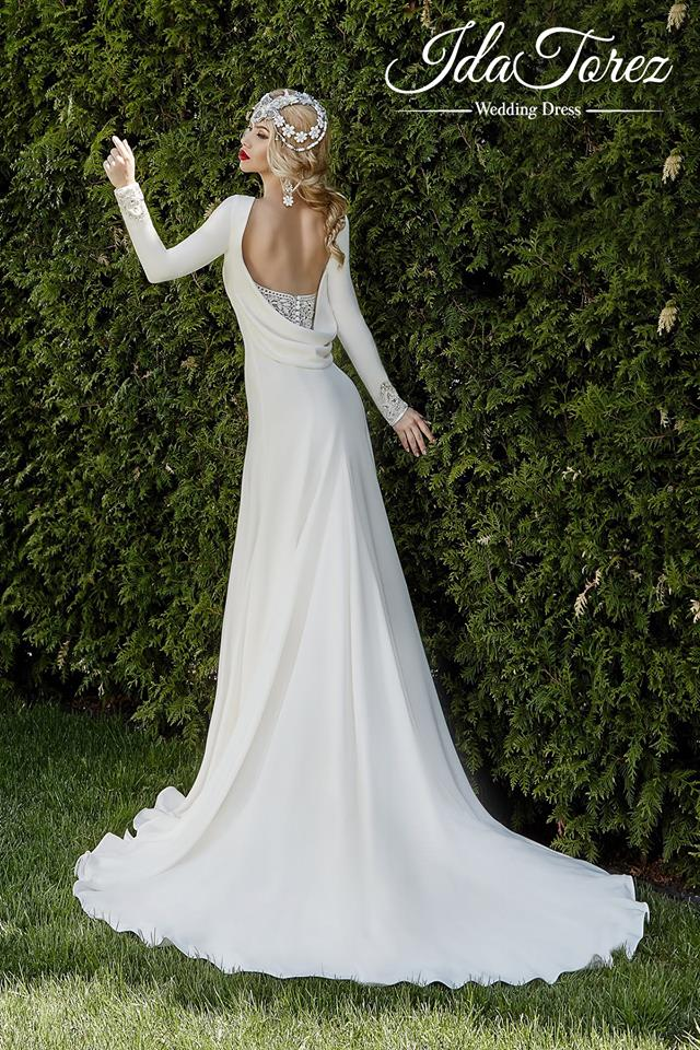 adding layers feathers and a plunging neckline are all popular wedding dress trends this season soft details and head pieces create a fairy tale look to